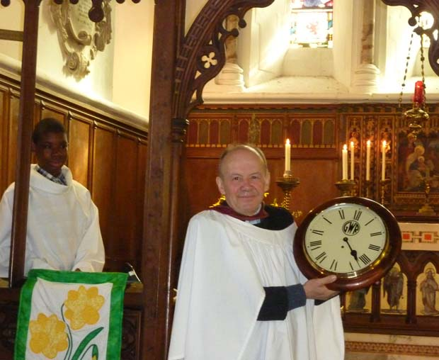 Ian Harman receiving his presentation clock after 40 years as organist at St Michael's